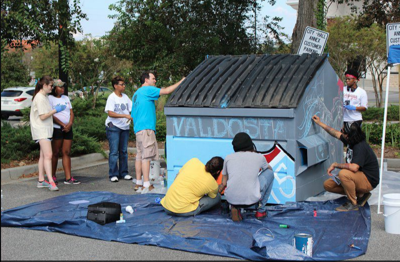 Image: LaShaunda Jordan. Charlie's Angels work on dumpster to beautify the city.