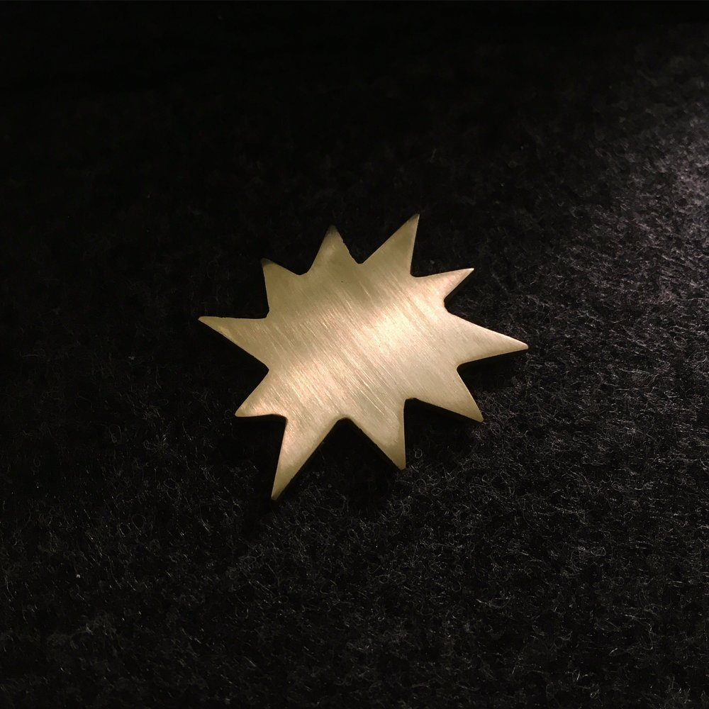 """POW""  - hand cut from solid brass  - available as ring & earrings  - contact for sizes, price, & availability"