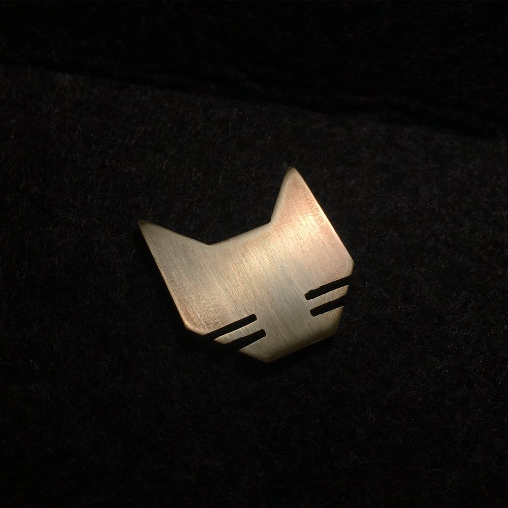"""FELINE""  - hand cut from solid brass  - available as necklace, ring, & earrings  - contact for sizes, price, & availability"