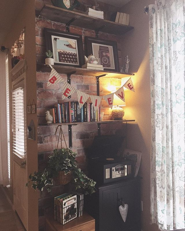 One of my favorite nooks of our home. I had this vision for open shelves, floor to ceiling here, right when we moved in. I love how ideas are living things that change over time. 🌟 I did these shelves myself with a little muscle power from my husband and brother. The brick is wallpaper- genius! Books, books, books...of course! The brown cabinet that the wire basket of kids books is on top of, my dad actually built and stained long ago. There are thrifted finds and pieces passed down from my grandmother. I aim to make every space show a little piece of us, be kid-friendly AND feel cozy. 😊💫