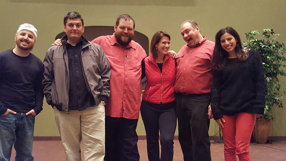 Ryan McChesney, Dave Zarbock, Dave Ebert, Angela Beckefeld, Jim Bushy, and Anna Yee pose after one of their shows. Their love for each other runs deep, wide, high and long.