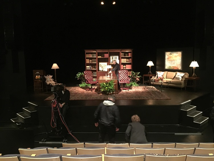 We entered the theater as the stage was still being prepared for the interview.  The library-themed set was designed and provided by Bittner's.