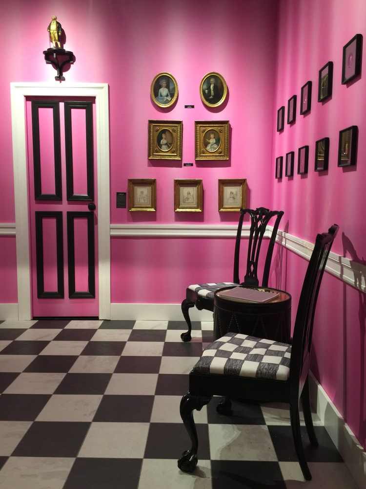 Elle Shushan's booth appeared to have a Dorothy Draper edge.  Painted black antique chairs were placed on a black and white floor and black and gilt wood framed paintings and photographs decorated the pretty pink walls.