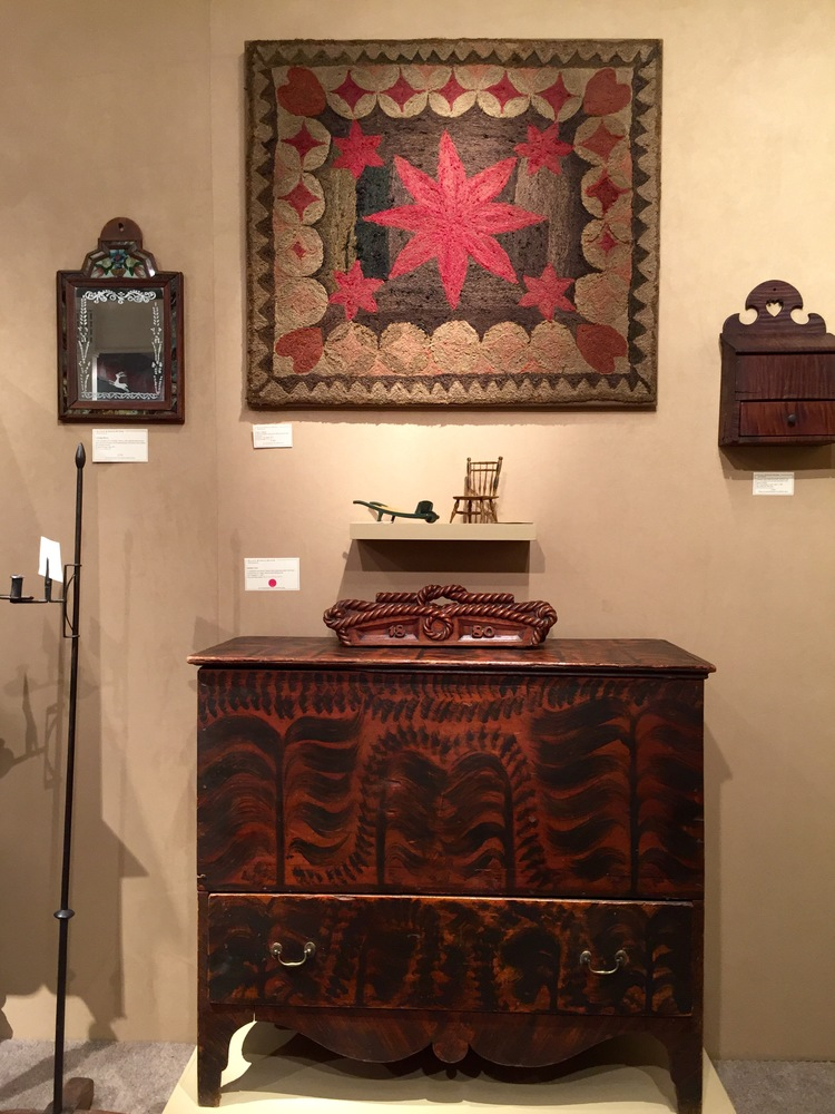 This vignette by Elliott & Grace Snyder featured a wonderfully colored antique hooked rug and a faux-grained blanket chest.