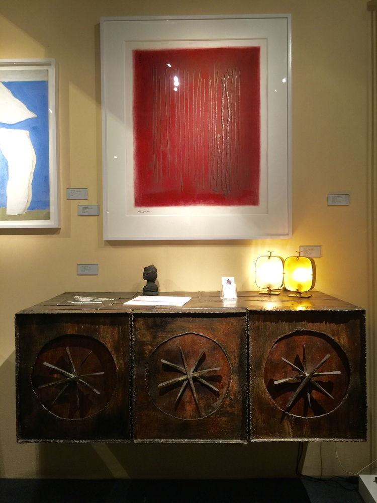 This captivating wall cabinet by Paul Evans is crafted of steel, gilt wood and bronze.  The red vertical striations in the lithograph by Adja Yunkers are a perfectly compliment to the brutalist piece.