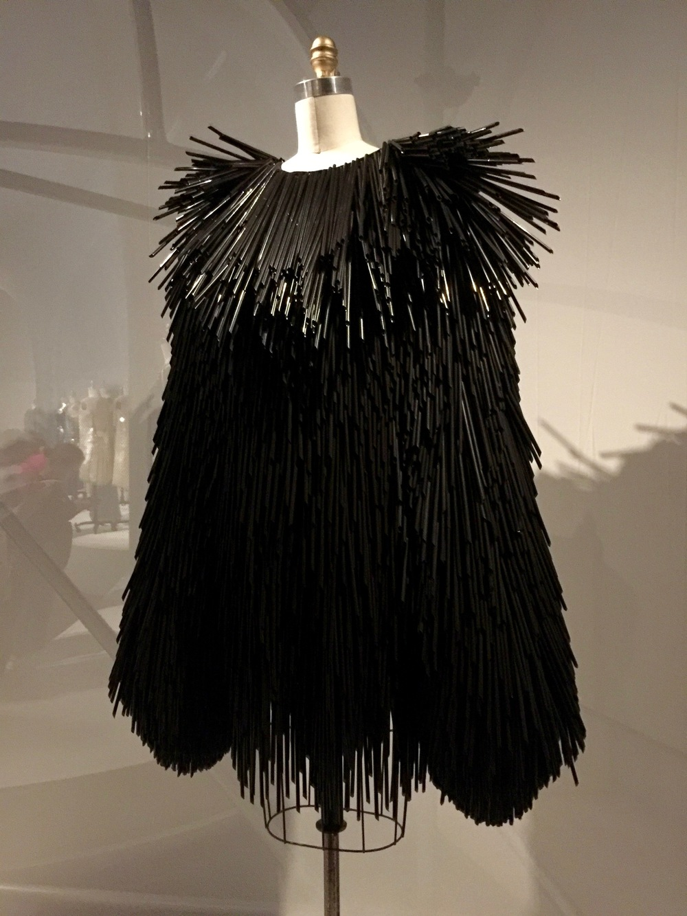 "Gareth Pugh DRESS, pret-a-porter  ""Every straw was cut by hand...They were attached individually with metal hardware- a little twisted jewelry fitting that hooked onto the fabric base.  On the runway, you could hear them before you saw them.  And they moved beautifully- like feathers caught in a gust of wind."" - Gareth Pugh"