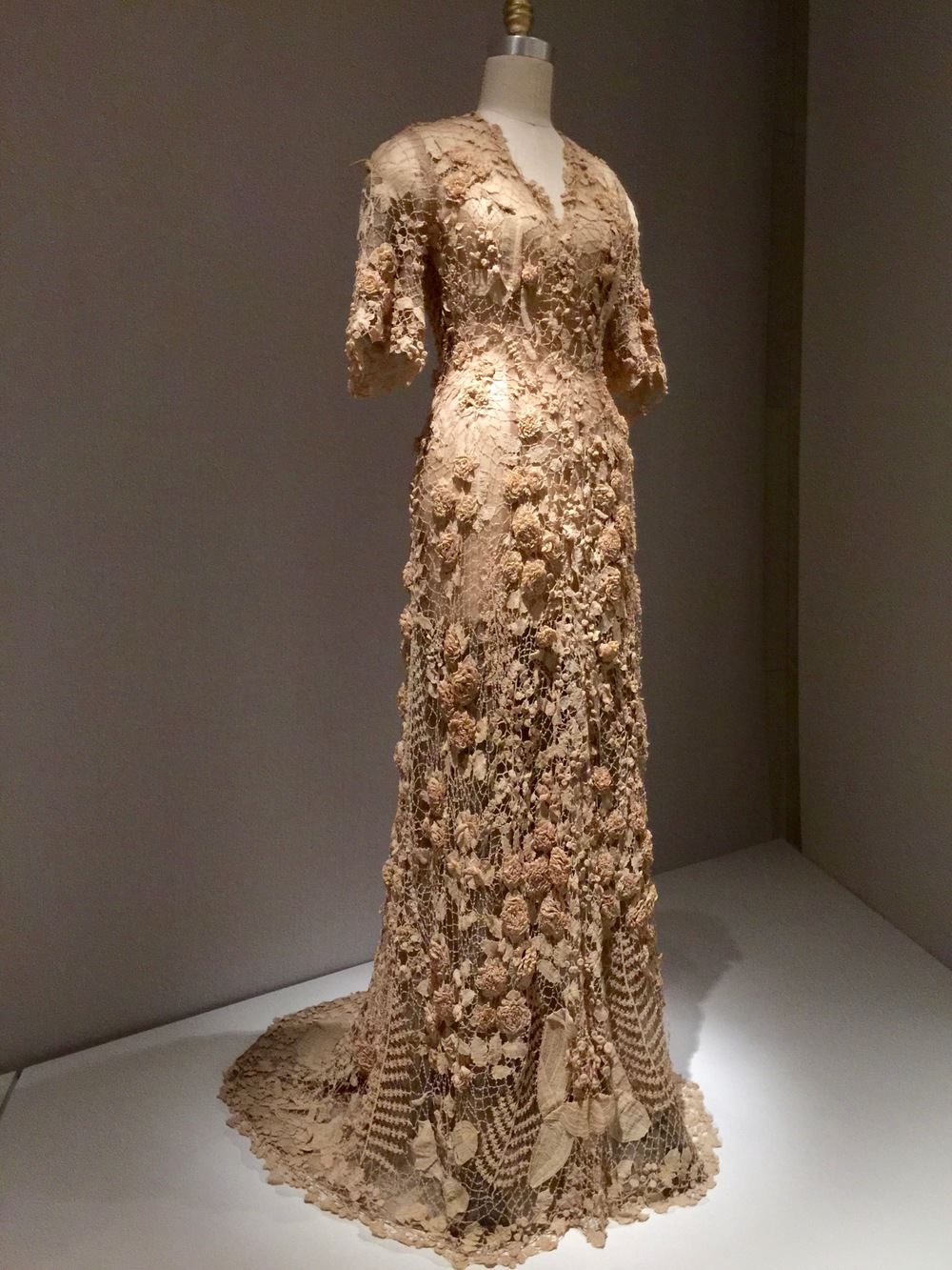 Irish WEDDING DRESS, Ca. 1870 Hand-crocheted cream cotton lace with three-dimensional motifs, including roses, lilies of the valley, hanging fuchsias, morning glories, buds and berries, and flat and folded leaves and ferns