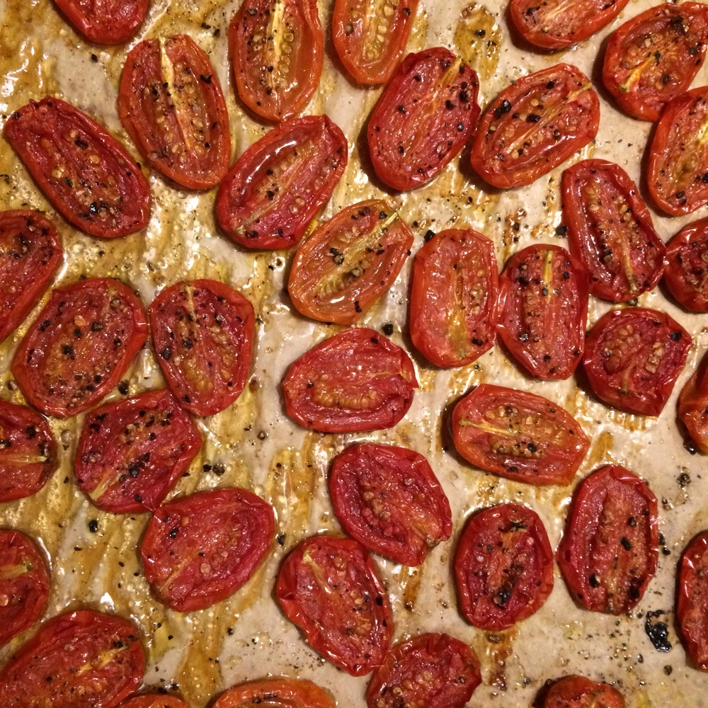 We have little Juliet tomatoes in our garden. I slice them in half, cover with a generous amount of olive oil, salt and pepper, and roast until much of their moisture has cooked off.