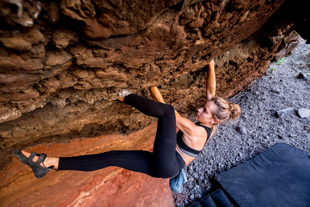 Vanessa on the 30' roof crack 'Goat Attack', in one of Haleakala's giant southern valleys. PC: Drew Sulock