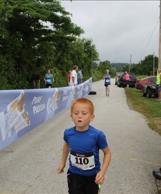 Kooper Hudson Baker finishing his first 5k May 31, 2014.
