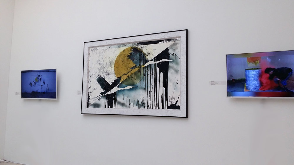 Artwork next to TV's showing explosive process videos