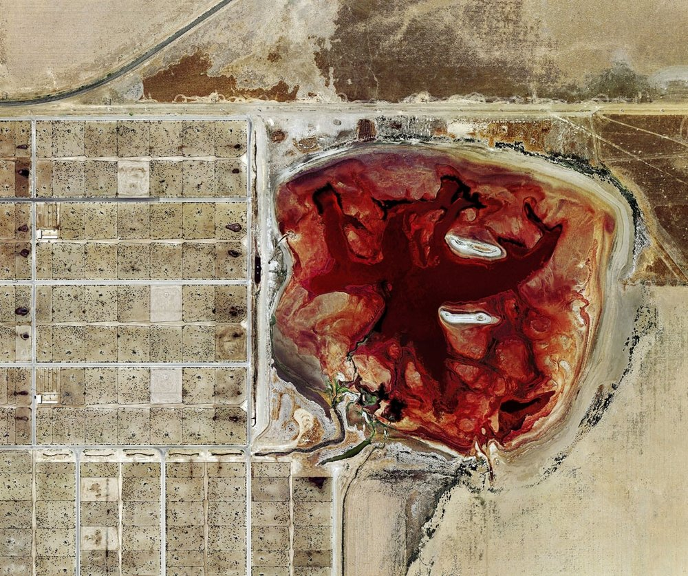 """According to the IPCC, ""Methane is even worse for global warming than carbon dioxide is."" / Photo of a cattle farm and its waste lagoon in Dalhart- Texas 2013 by  Mishka Henner  titled ""feeder"""
