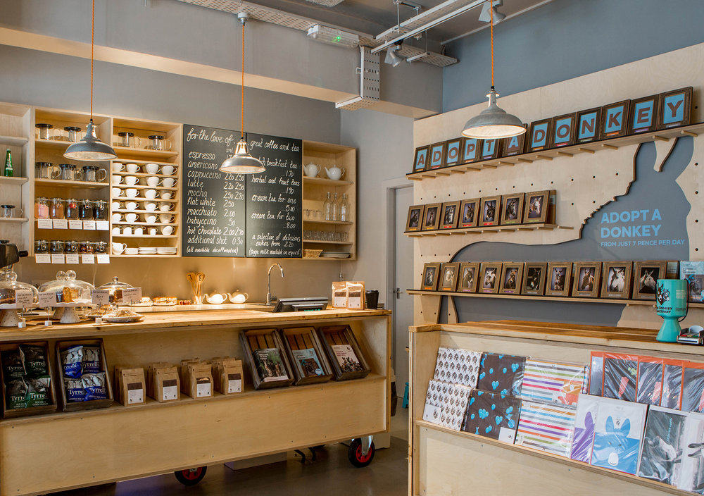 The Donkey Sanctuary community stores:  The social store concept we designed for the charity incorporates a café serving cakes from local businesses and a retail area selling souvenirs and pre-loved donated goods. The stores also host special events and   have become community destinations.