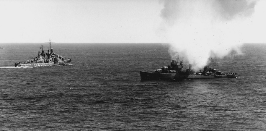 USS Phelps (DD-360) during the third day of the Battle of Midway Island, on 6 June 1942. The cruiser USS Atlanta (CL-51) to the left. Official U.S. Navy photograph # 80-G-11638.