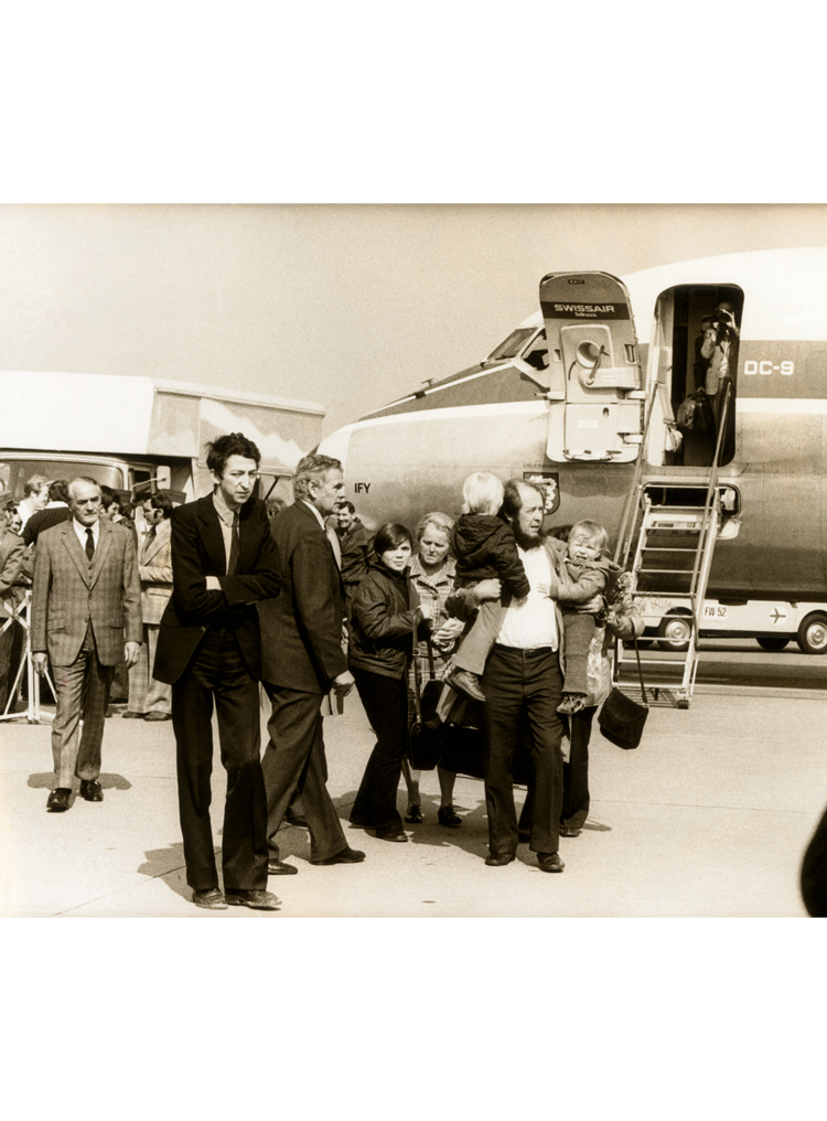 7.8 ┆     Aleksandr Solzhenitsyn greets his family at Zurich airport.   29 March 1974 Credit: Sven Simon