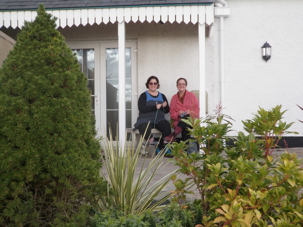 my Singer and Brenda Dayne, caught knitting on a break at the P3 retreat at Beggar's Reach, Pembrokeshire, Wales