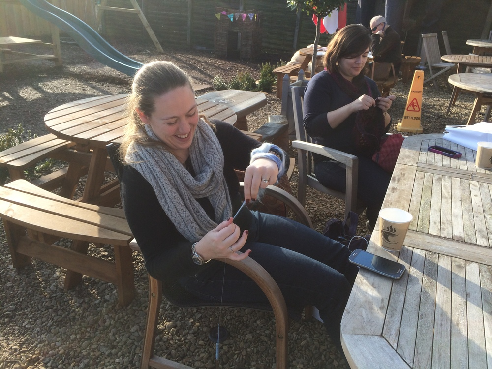 Helen and Kelly get some spinning and knitting done while enjoying a break in the sunshine at The Shed.