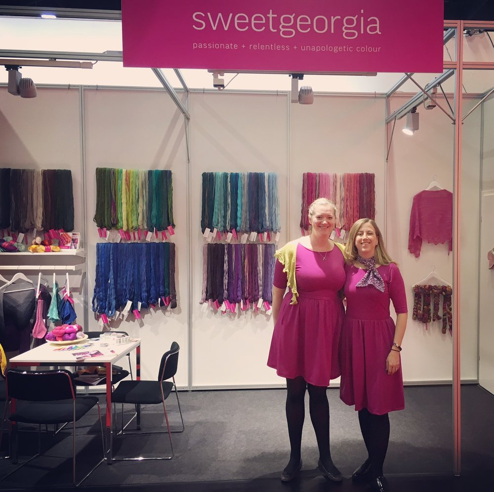Carmen and Allison welcome colour lovers to the SweetGeorgia Yarns stand at H+H