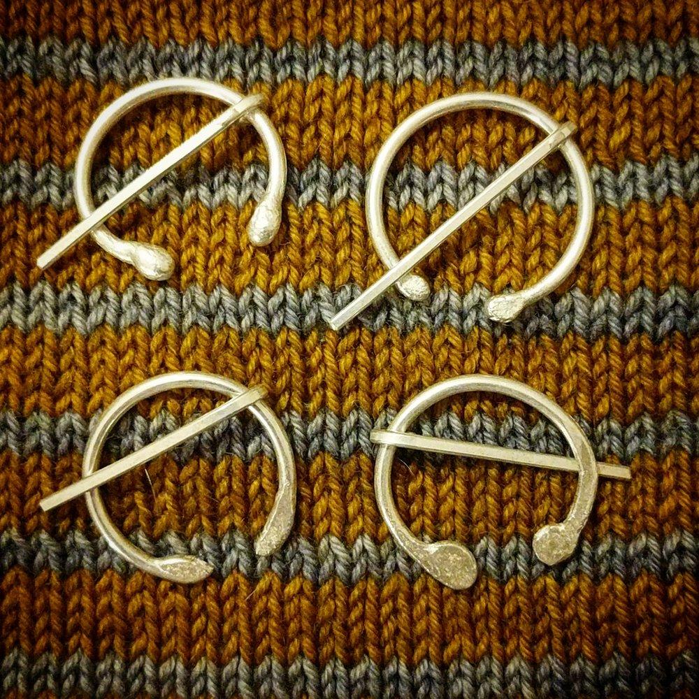 Silver penannular pins