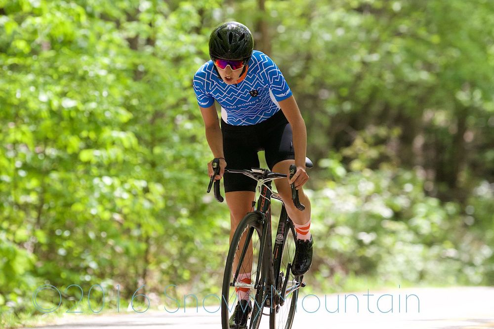 Daphne gets out of the saddle as she crests the climb. Photo by SnowyMountain Photography.