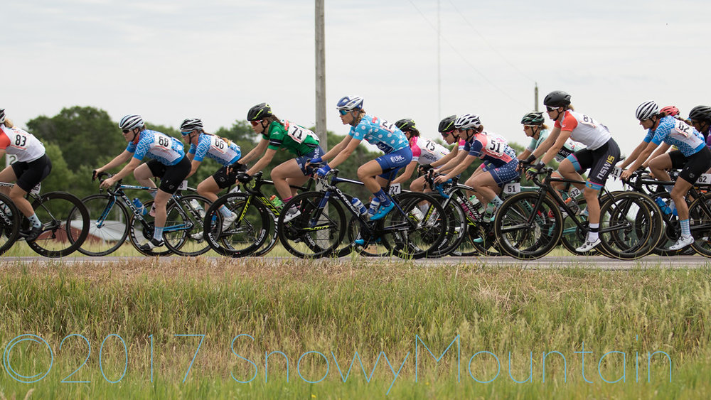 CWEC riders Lauren, Lily, and Heather in the peloton during the North Mankato Road Race