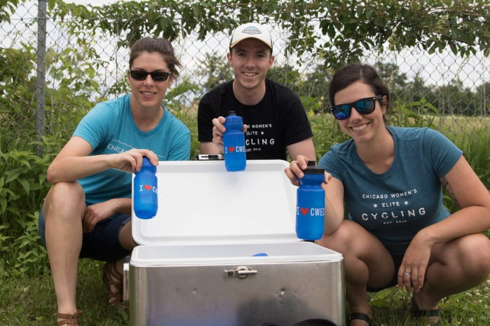 Jenny, Kevin, and Elizabeth get bottles ready for the riders