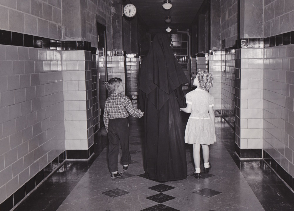 10-Sr and Kids Hallway 1950s.jpg