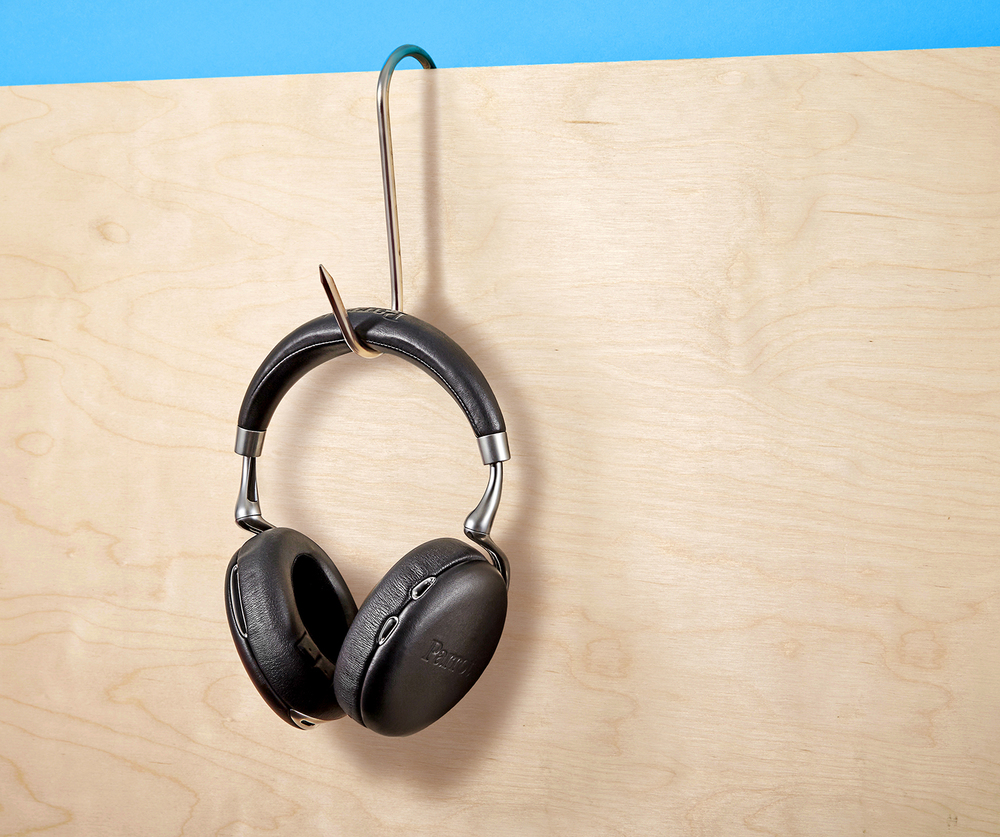 Advertising product photography headphones on wood pannel and blue. Created in London still life studios