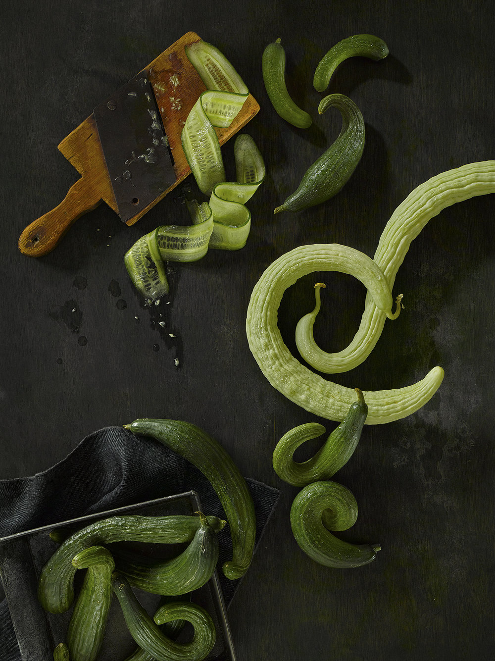 Creative still lifestyle food photography, Curly cucumbers arranged in lifestyle setting by London photographer chris howlett