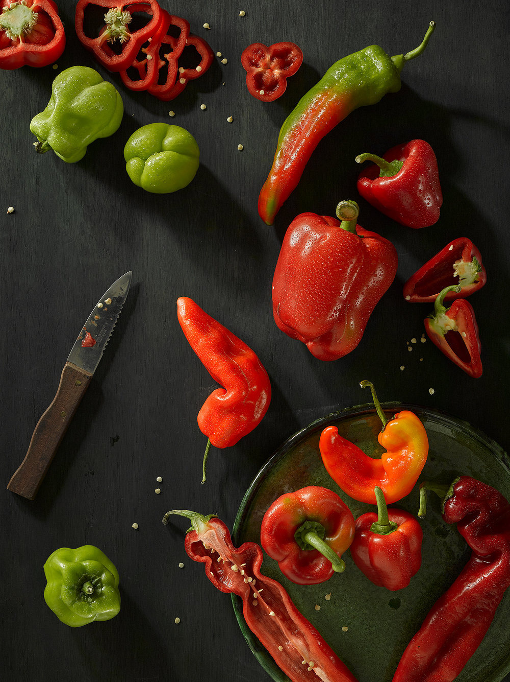 Lifestyle food photography pepper collection seed and all. Slice peppers arranged in still life composition creating adverting style food photography