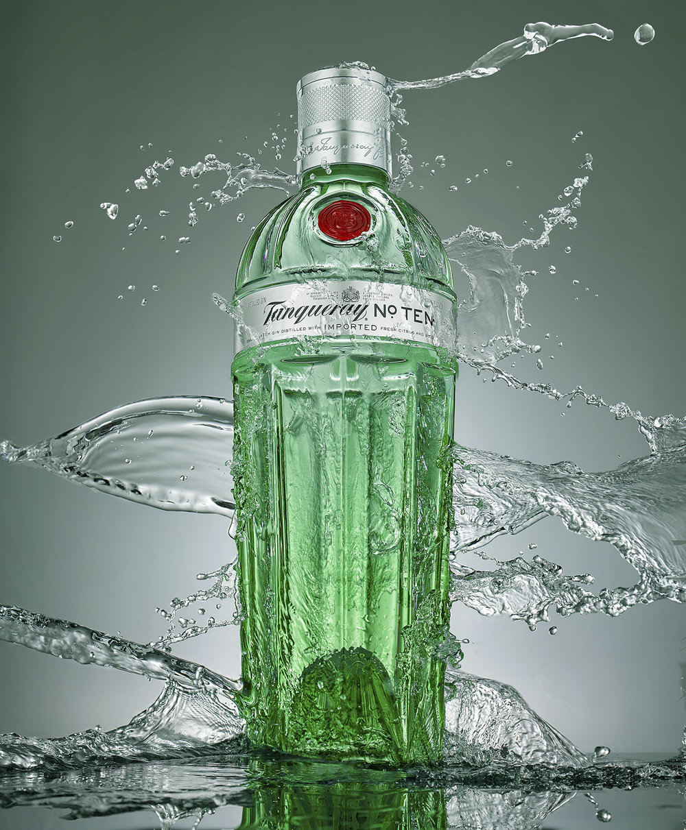 Creative high speed product photography. Drinks with water splash advertising still life photography All images completed in London by food and drinks photographer chris howlett