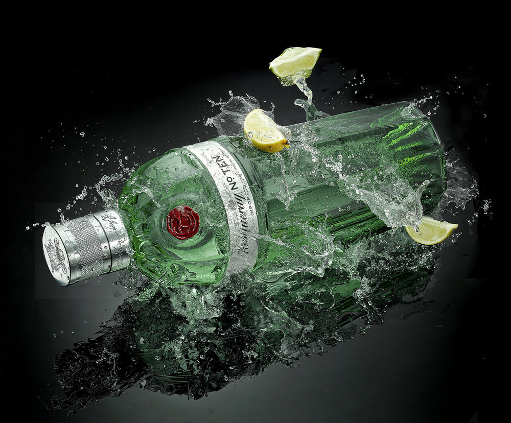 Advertising high speed liquid photography. Drinks cocktails alcohol gin bottle with splash. product food and drinks photographer in London