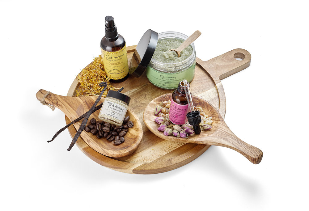 lifestyle beauty cosmetics on wooden boards with ingredients and products creatively placed on the advertising still life photograph.