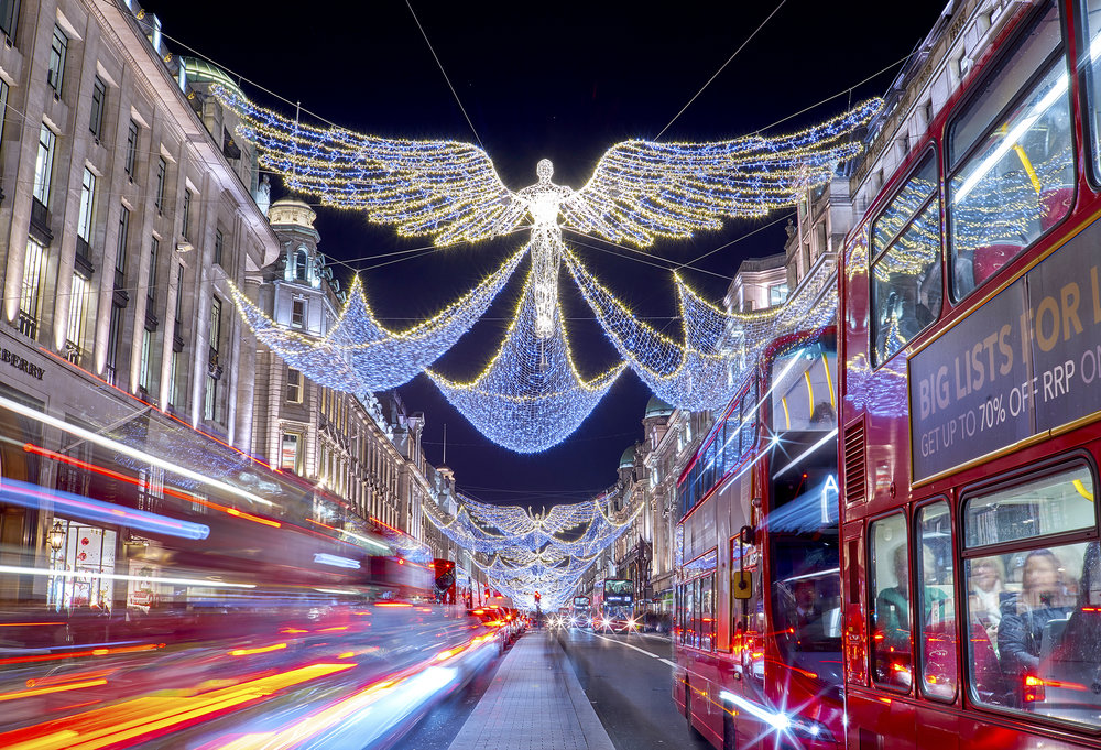 London Regent street Christmas lights 2016, with buses and bright festive lights
