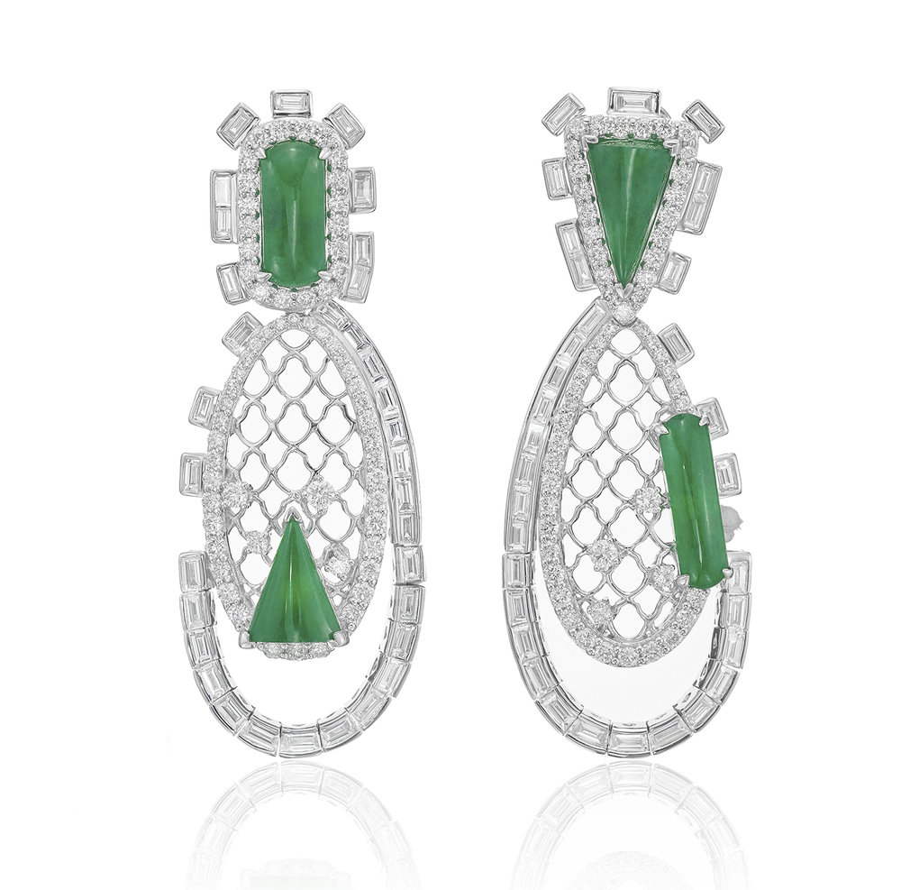 London packshot jewellery photography, two emerald earings with reflection from product photographer chris howlett