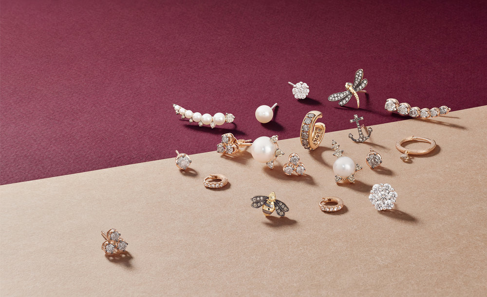 Jewellery photographer London. This creative still life jewellery collection was photographed for London based jewellery company. Featuring small and intricate charms and earring photographed in high detail, packshots and product photography from Howlett photography