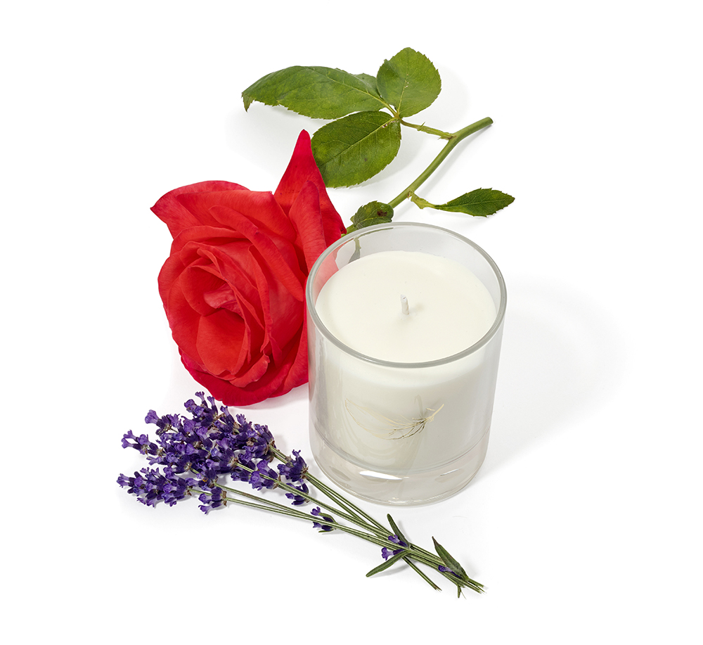 product packshot photographer from London candles with roses and lavender ingredients and products