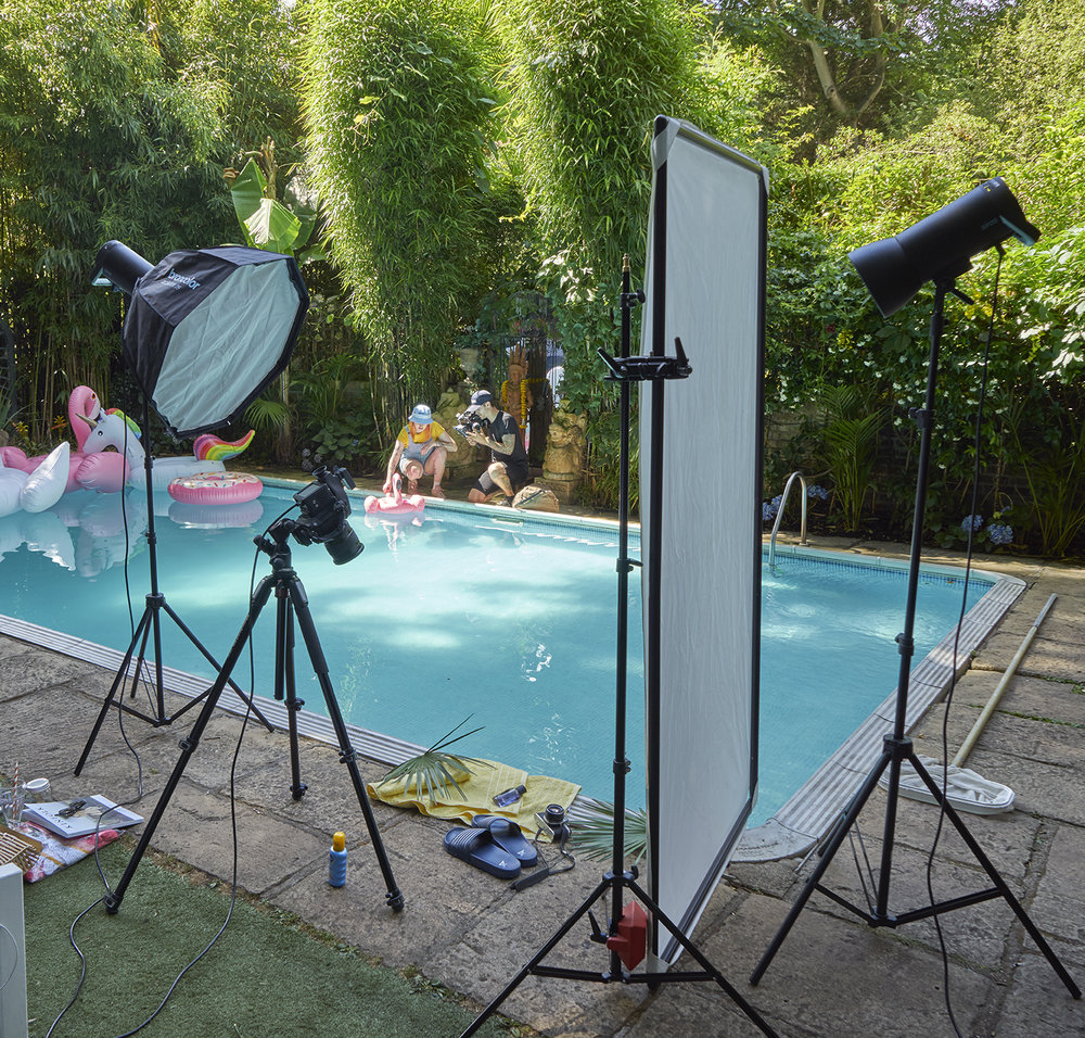 A behind the scenes shot form recent location photography for still life cosmetic photographer chris howlett .