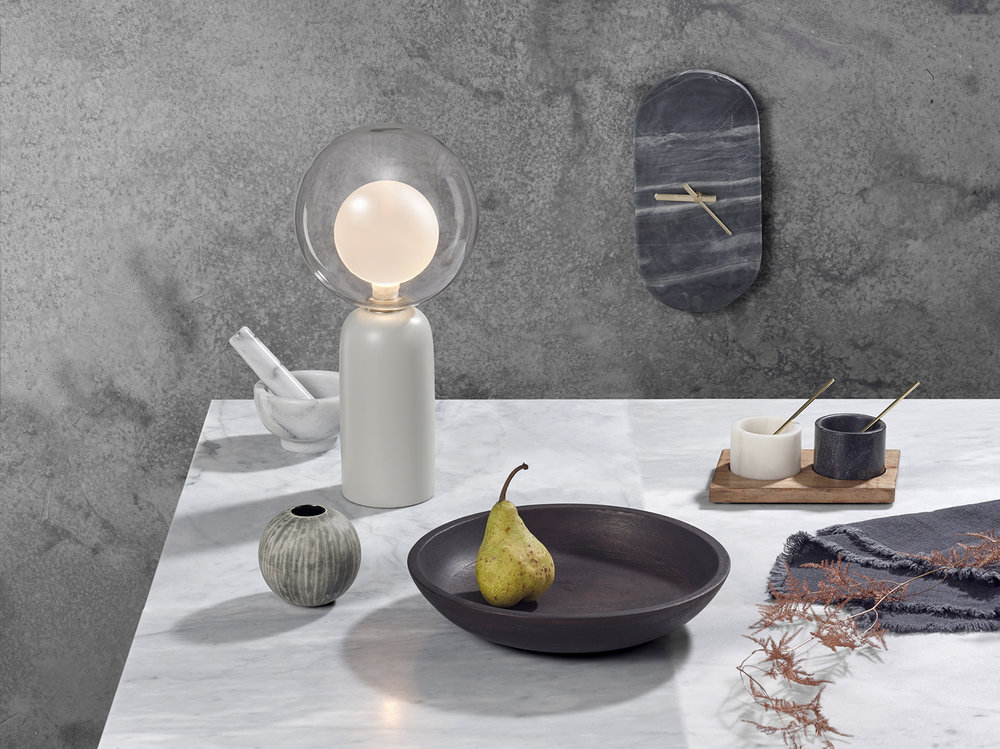 Still Life interior product photography. Home and Lifestyle products placed on luxury marble table top with concrete textured background. The creative still life image used for promotion, shot in London studio by chris holwett photography