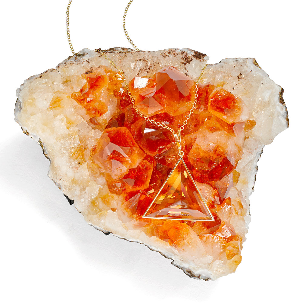 creative product jewellery photography. crystal pendent on citrine crystal studio photography by chris howlett