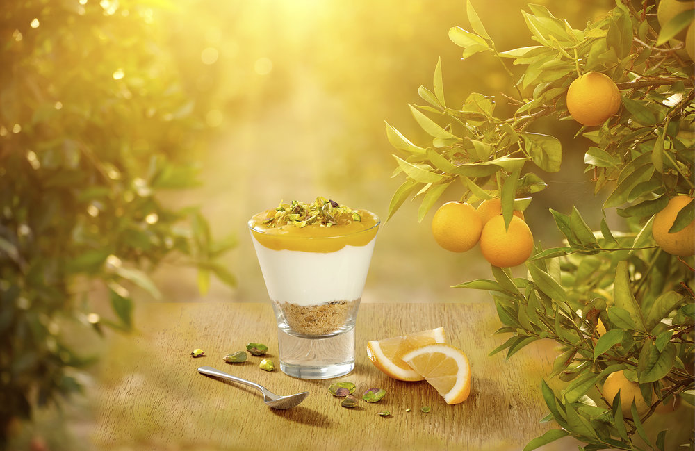 Citrus fruit dessert made with yogurt product and fresh fruit. Creative still life food photographer chris howlett created the advertising product packshot in London studio
