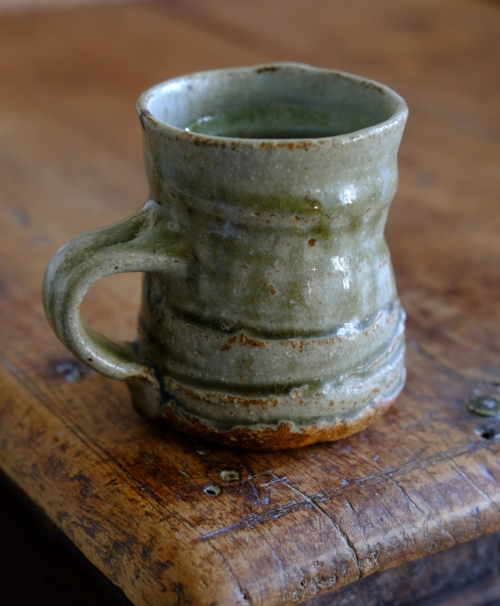 Coffee mug: oak-ash/granite & marble worktop sawdust/clay glaze.