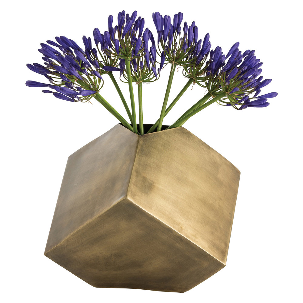 The geometric shape of this lovely vase is so beautifully highlighted by the brass finish!  Even without the flowers, this accent piece is absolutely stunning!