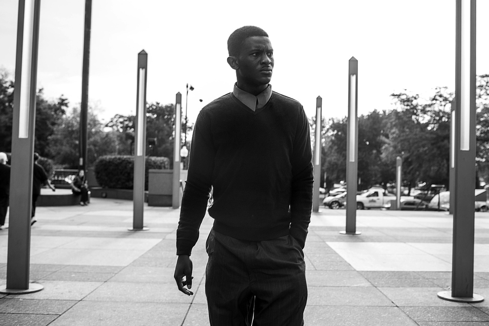 Augustin approaches the entrance to the Cook Country Courthouse in Chicago for a preliminary hearing on his trial stemming from a July 15 arrest for robbery.