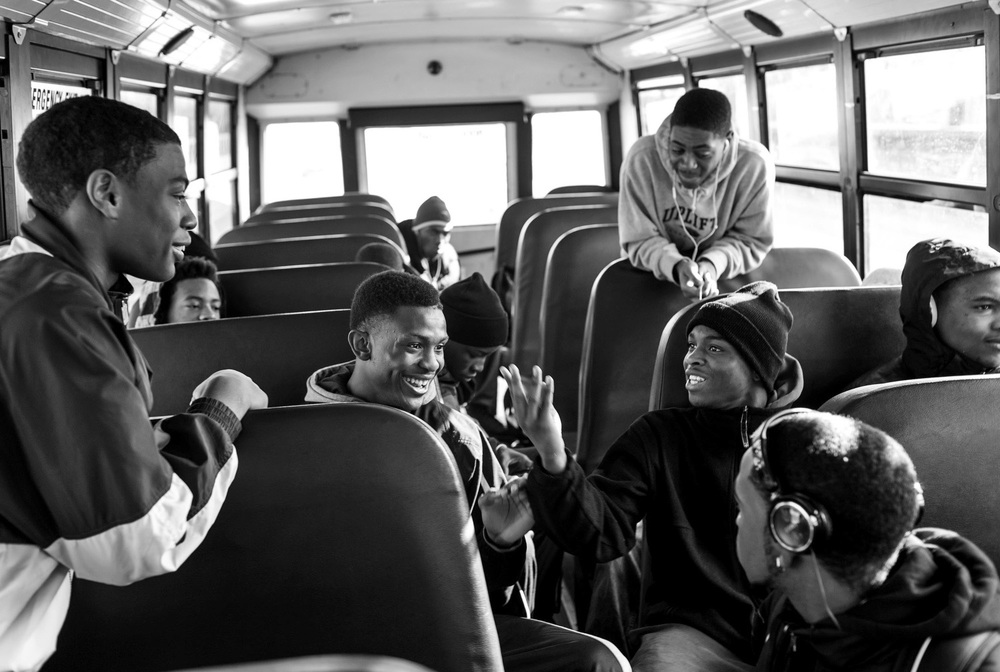 Augustin and his high school teammates ride the bus to a game in Mundelein, IL.