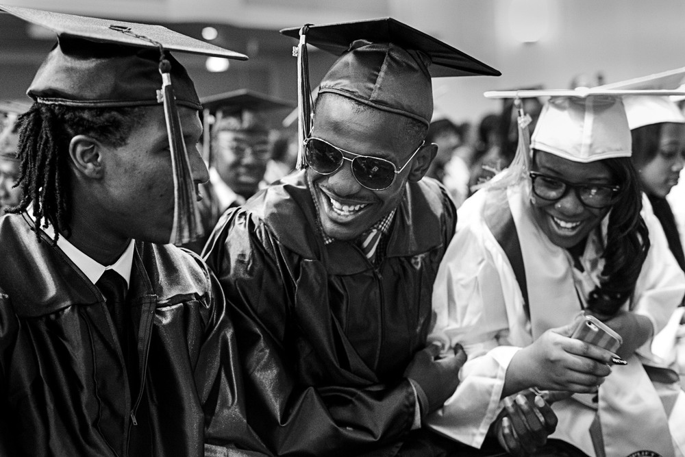 Augustin smiles with his classmates at the 2014 Uplift graduation ceremony.