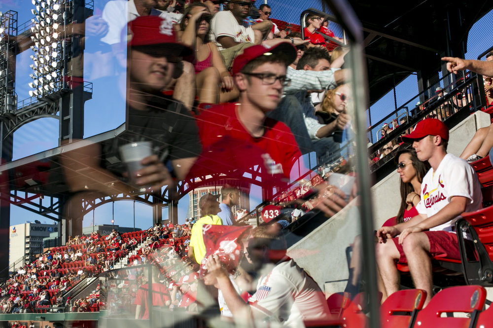 Fans watch the game from the upper deck in right field at Busch Stadium in St. Louis, MO.