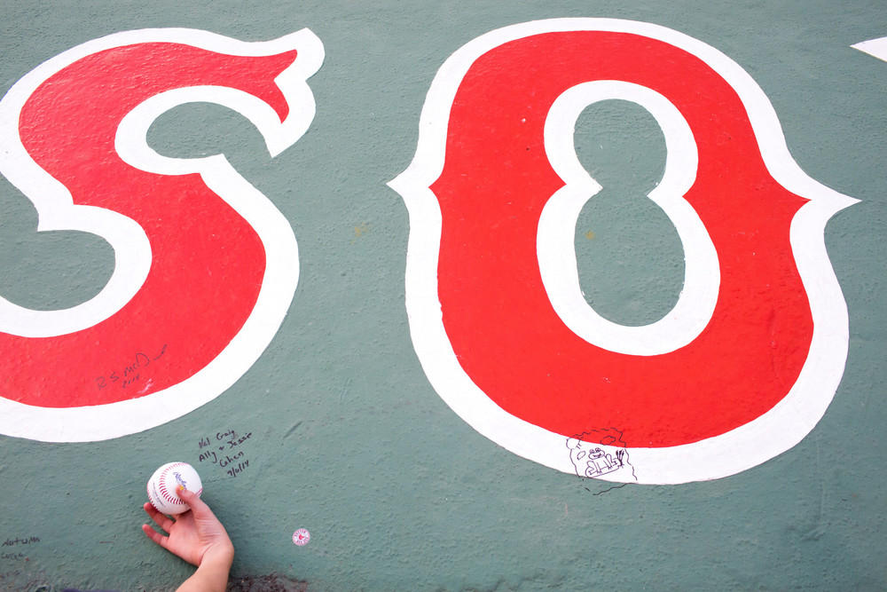 A young fan waits for an autograph at Fenway Park in Boston, MA.