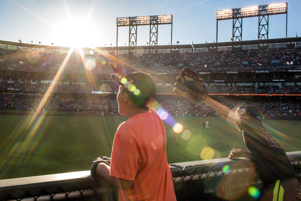 Fans try to get a ball from outfielder Hunter Pence before the start of the game at AT&T Park in San Francisco, CA.