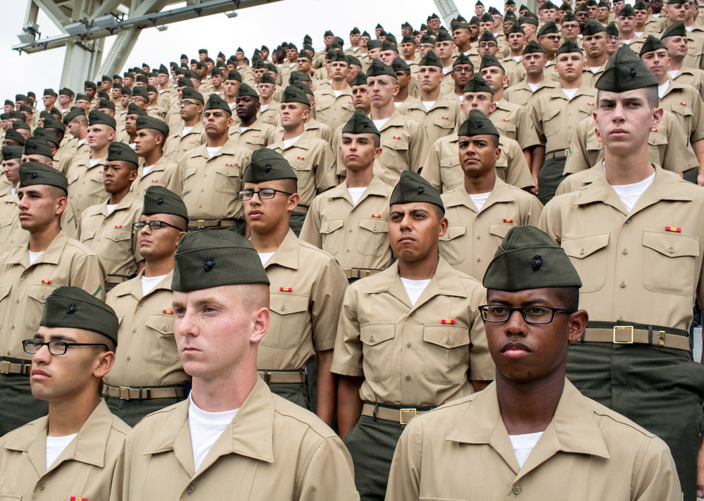 Recruits and graduates of the Marine Corps Recruit Depot in San Diego stand at attention before a game at Petco Park in San Diego, CA. At each home Sunday game, the Padres honor members of the military.